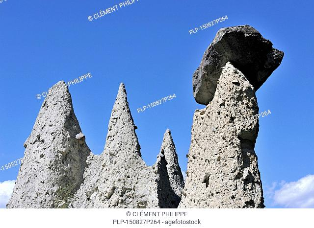 The Pyramids of Euseigne in the canton of Valais / Wallis, Switzerland. Rocks of harder stone stacked on top protect the columns from rapid erosion