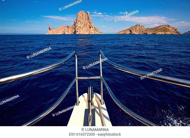 Boating sailing in Ibiza near es Vedra island on Mediterranean sea of Balearic