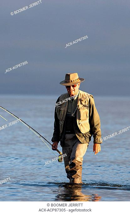 Two fly fishing buddies discuss the fishing while at Cluxewe Resort near Port McNeill