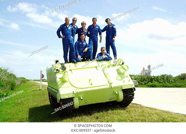 05/15/2002 - The STS-111 and Expedition 5 crews pose on top of the M-113 armored personnel carrier they practiced driving during emergency egress training at...