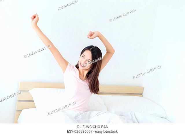 Woman stretching hand at morning