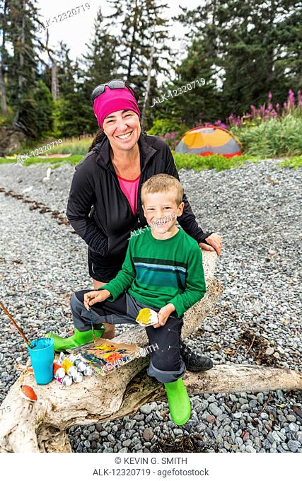 Mother and son with watercolor painting supplies, Hesketh Island, Southcentral Alaska, USA
