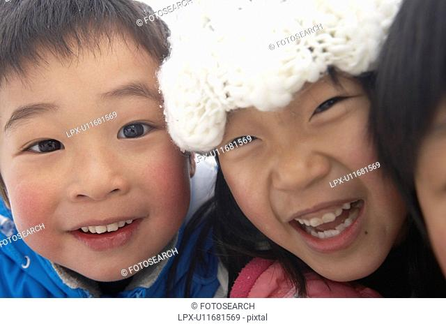 Close-up of boy and girl, Yamagata Prefecture, Japan