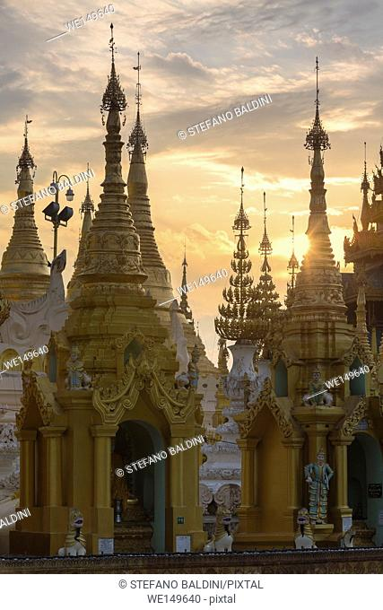 The spires of Shwedagon pagoda shortly after sunrise, Yangon, Myanmar