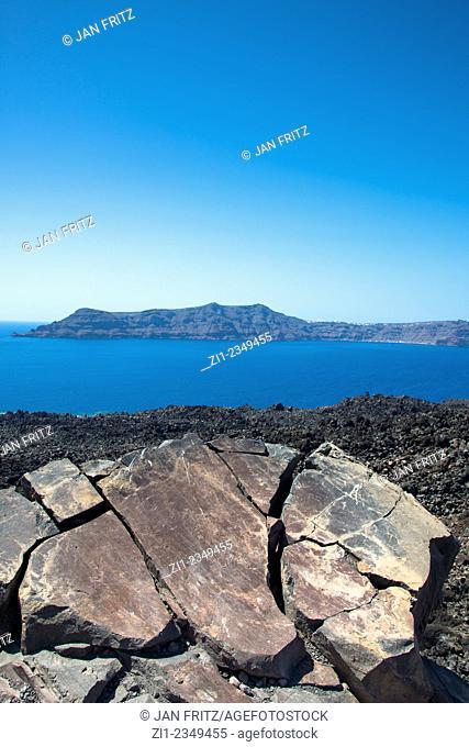 big cracked volcanic rock at Nea Kameni in the caldera of Santorini in Greece