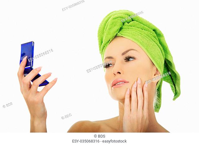 Beautiful spa woman with a mirror
