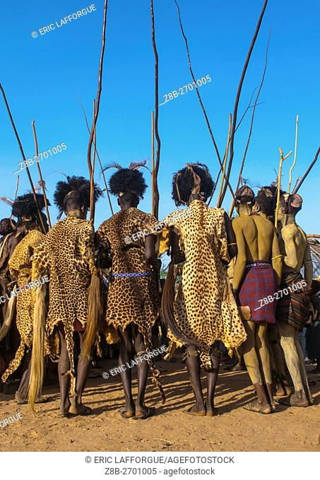 Ethiopia, Omo Valley, Omorate, dassanech men with leopard skins and ostrich feathers headwears during dimi ceremony to celebrate circumcision of teenagers