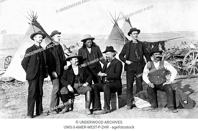 Wyoming: c. 1875.Frontier men at an Indian camp in Wyoming