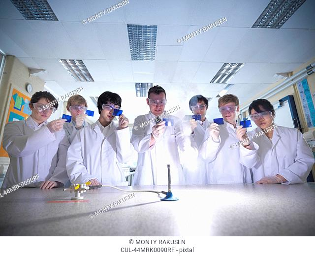 Chemistry teacher and students in lab
