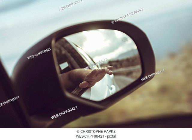 Greece, Crete, hand in rear-view mirror of a car