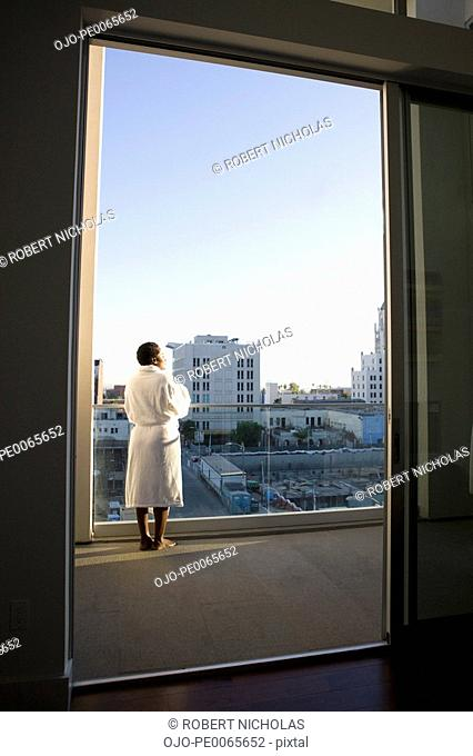 Woman enjoying view from balcony