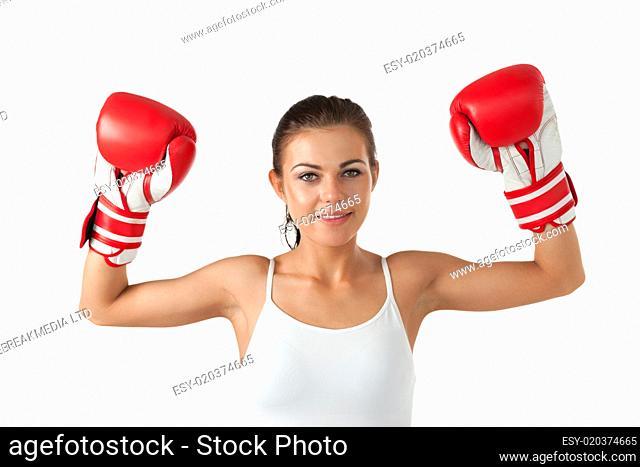 Female boxer raising her arms