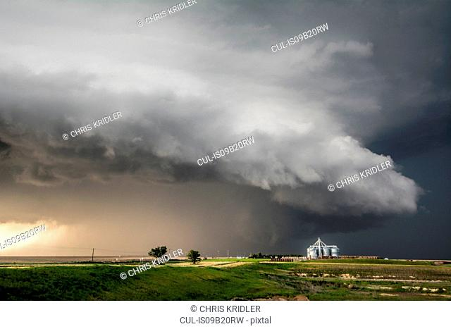 A tornado-producing supercell thunderstorm spinning over ranch land near Leoti, Kansas