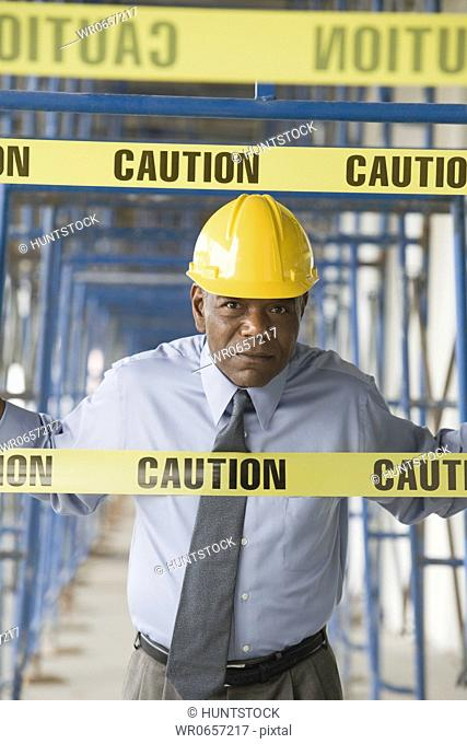 Portrait of a male architect standing at a construction site