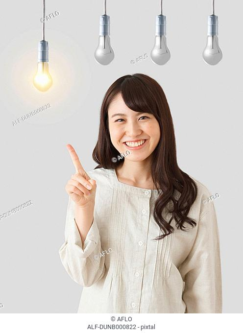 Japanese woman with light bulbs