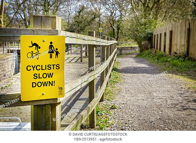 A warning sign for cyclists to slow down at the 14 locks, near Newport on the Brecon and Monmouthshire canal, south Wales, UK
