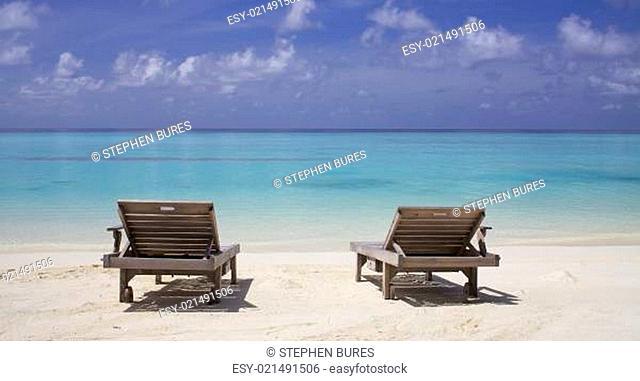 Lounge chairs on ocean beach