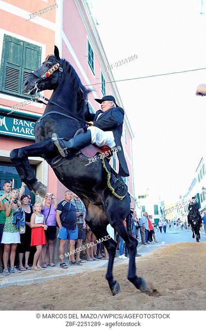 A horse rearing, typical horse riding during the traditional celebration of San Nicolas in Menorca, Spain