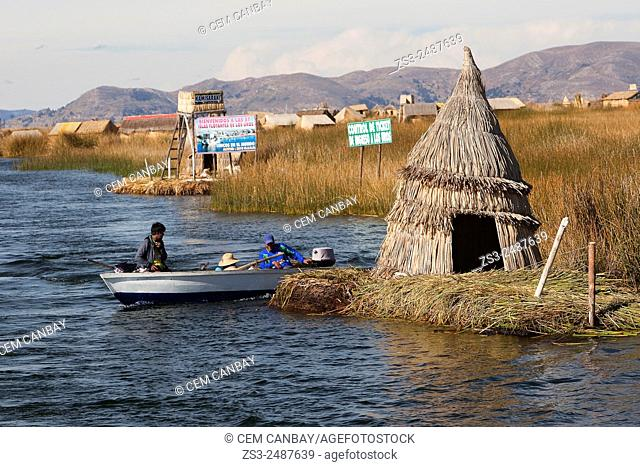 Aymara people in a boat near an island, Uros Islands, Lake Titicaca, Puno, Peru, South America