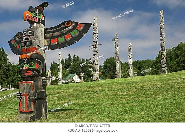 Totem poles at cemetery Alert Bay Vancouver Island British Columbia Canada totem pole