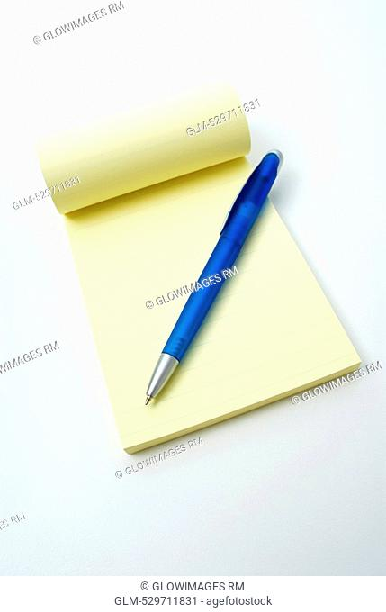 Close-up of a pen on a notepad