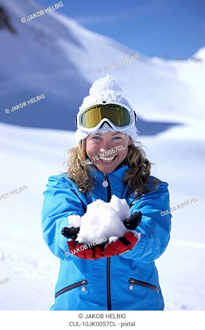 Woman laughing, holding snowball