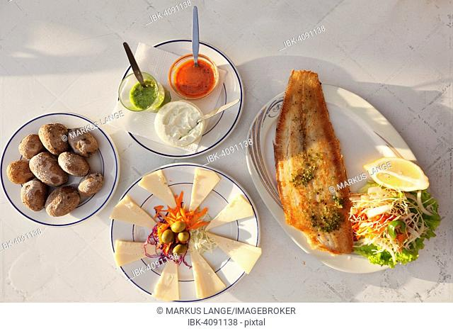 Papas arrugadas con mojo, wrinkled potatoes with mojo sauce, fried fish and cheese platter with Canarian cheese, La Gomera, Canary Islands, Spain