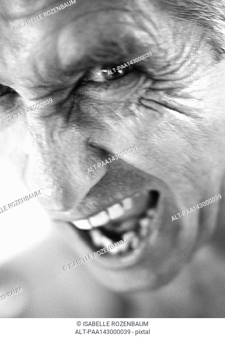 Mature man making face, portrait, close-up, b&w