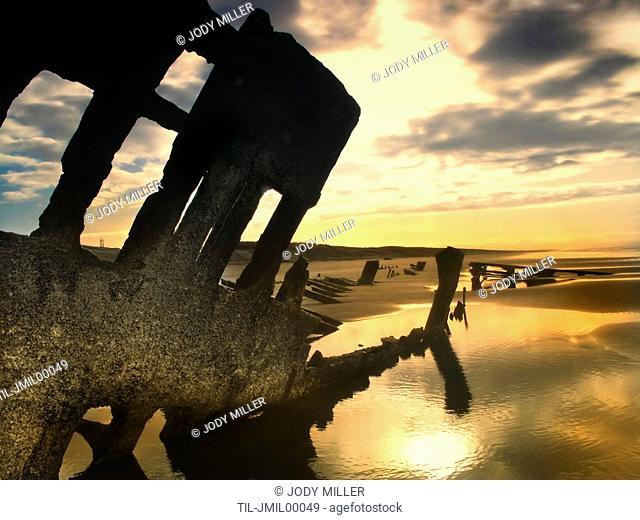 Shipwreck on as beach at sunrise
