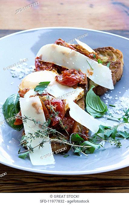 Shakshuka on ciabatta with tomatoes, chilli and Parmesan cheese