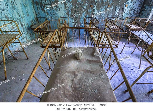 Infant cribs in Hospital No. 126 of Pripyat ghost city, Chernobyl Nuclear Power Plant Zone of Alienation around nuclear reactor disaster, Ukraine