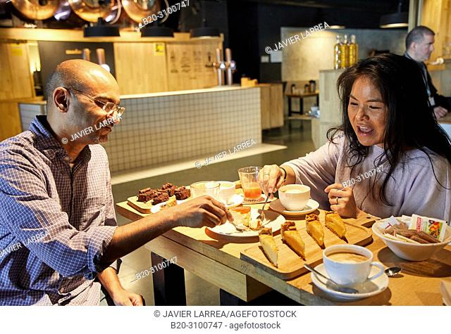 Breakfast in Cafe Tabakalera, Gastronomic tour, couple tourists, Donostia, San Sebastian, Gipuzkoa, Basque Country, Spain, Europe