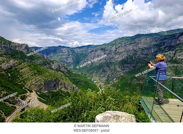 Albania, Shkoder County, Albanian Alps, Cem Canyon, observation point, hiker photographing