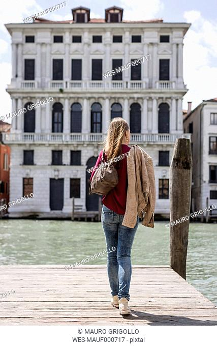 Italy, Venice, back view of tourist on a jetty looking at view