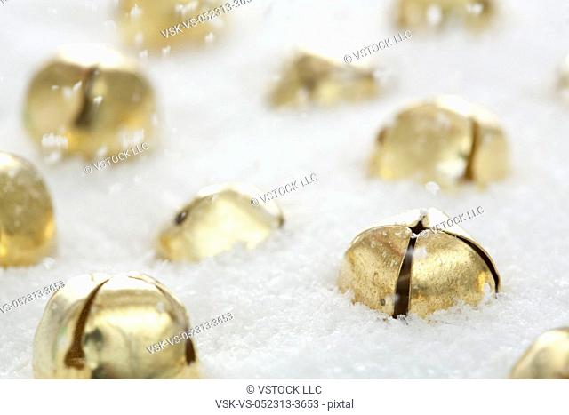 Golden jingle bells in snow