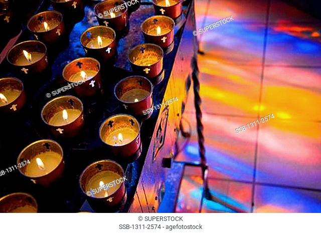 Votive candles burning in a cathedral, St. Francis Cathedral, Santa Fe, New Mexico, USA