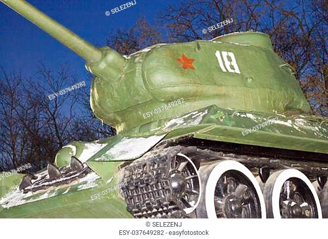 The old tank of times of World War II on a pedestal