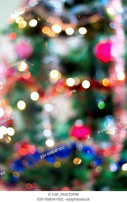 Blured background of a christmas tree with colourful lights