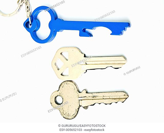 Couple keys and a blue stainless steel key's keychainisolated on white background