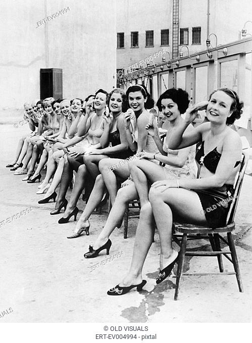 Group of women sitting together on chairs All persons depicted are not longer living and no estate exists Supplier warranties that there will be no model...