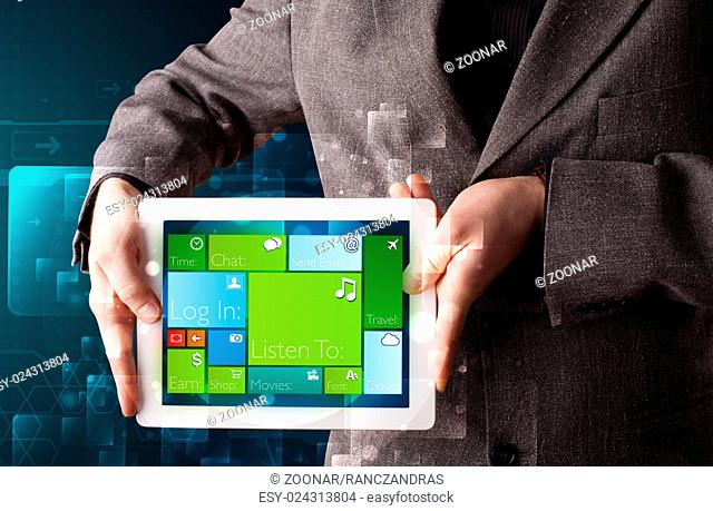 Businessman holding a tablet with modern software operational system