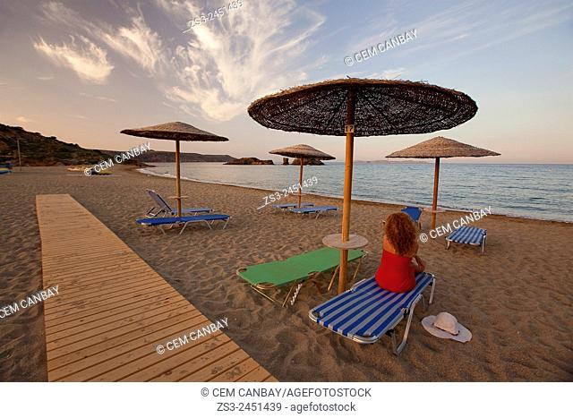 Woman and thatched umbrellas at the sandy Vai beach at sunset, Lasithi Region, Crete, Greek Islands, Greece, Europe