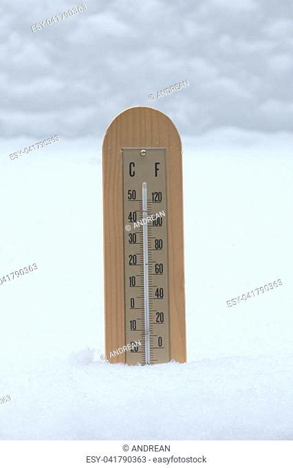 a temperature meter in the snow in a very cold day