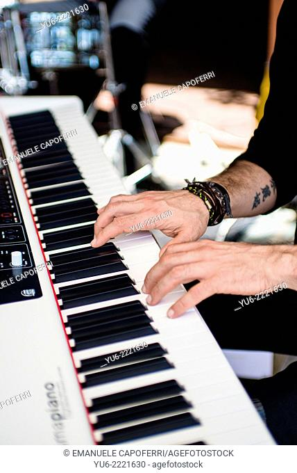 The hands of a pianist playing the keyboard