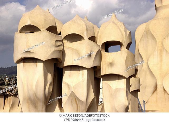 Sculpted chimneys on rooftop of La Pedrera, Barcelona, Spain