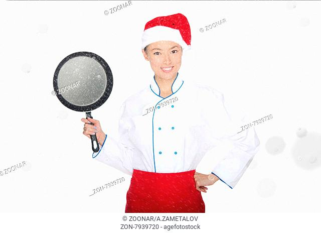 smiling asian chef with frying pan and Christmas hat in falling snow