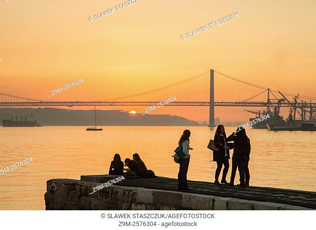 Winter sunset on river Tagus in Lisbon, Portugal. Looking towards 25 April Bridge