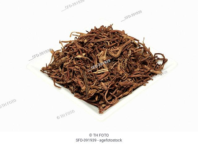 Dried tatarian aster root on a plate