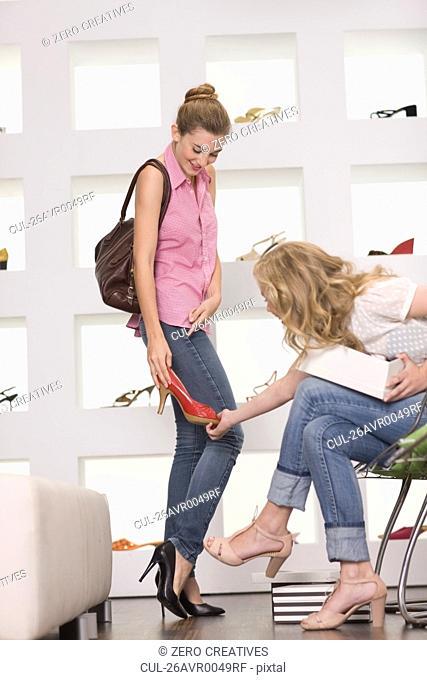 Girls in a shoe shop
