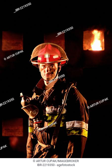 Firefighter in front of a burning building